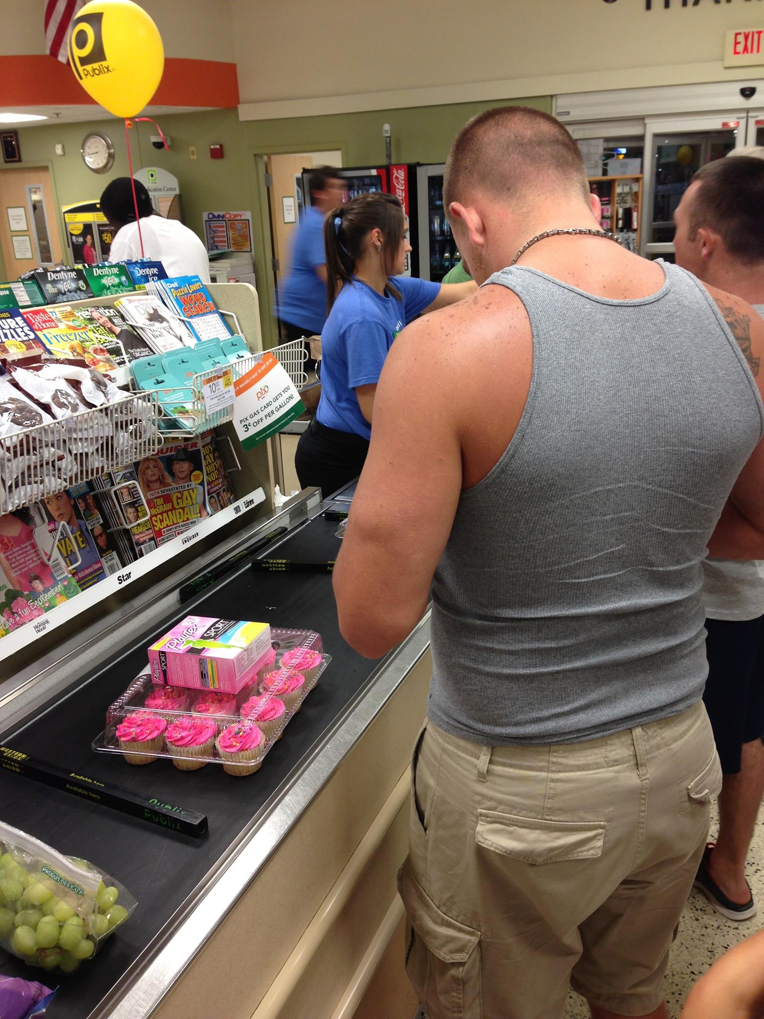 Be like this man. Buying tampons and cupcakes for a very fortunate woman.